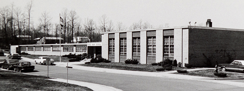 Black and white photograph of the front entrance of Kings Park Elementary School, circa 1968.